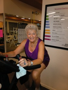 Sue Moore preparing for her ride at Iron Elks Fitness Center